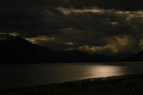 Pangong Tso under a partial moonlit night sky