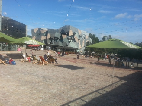Fed Square! With free-wifi and lay back chairs and plenty of free events and screenings on a big screen its quite the place to hang out.